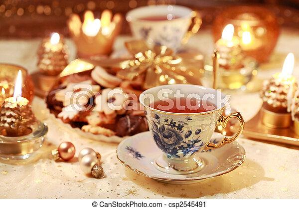 Hot tea with sweet cookies - csp2545491