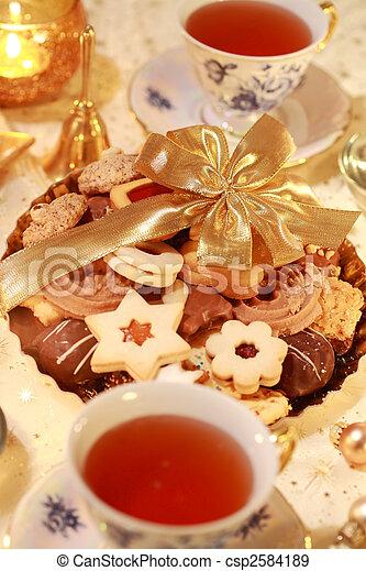 Hot tea with sweet cookies - csp2584189