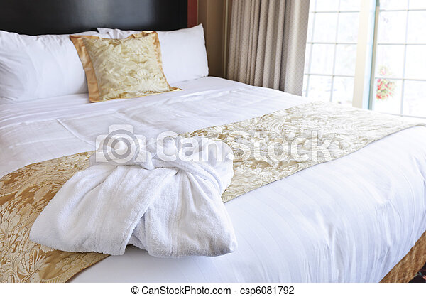 Hotel bed with bathrobe - csp6081792