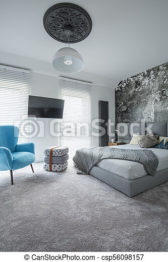 Hotel interior with blue armchair