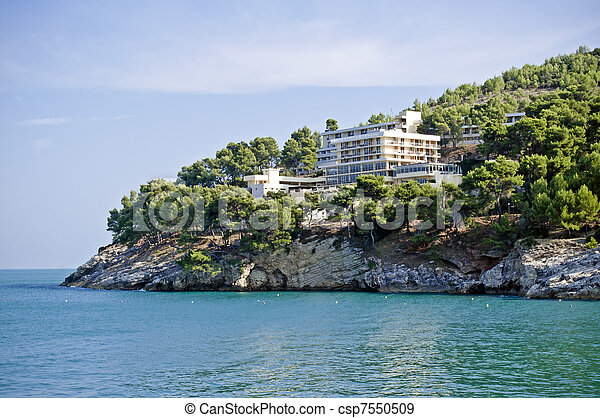 Hotel on the rocky beach in south Italy - csp7550509