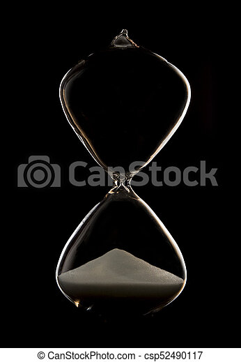 Hourglass in a dark studio with rim lighting and all the sand at botom - csp52490117