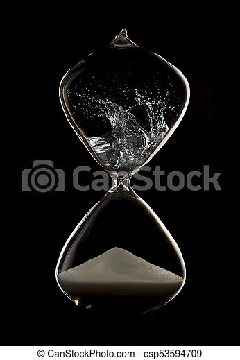 Hourglass in a dark studio with rim lighting and smoke in the top - csp53594709