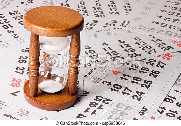 hourglass on calendar sheets - csp5938646