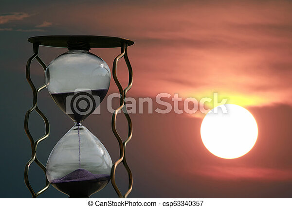 hourglass on the background of a sunset - csp63340357