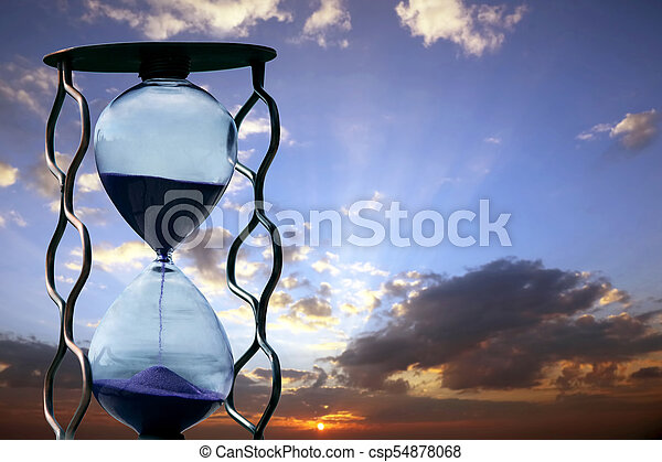 hourglass on the background of sunset - csp54878068