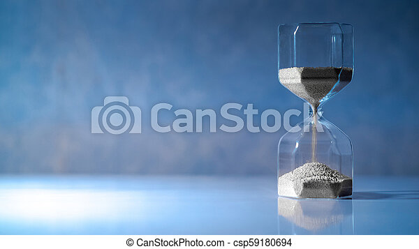 Hourglass on white table, Time passing concept - csp59180694