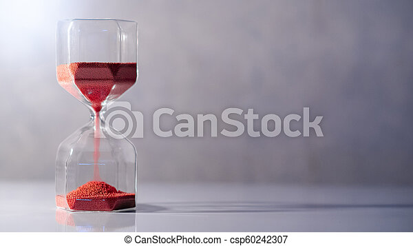 Hourglass on white table, Time passing concept - csp60242307