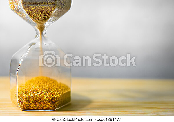 Hourglass on wooden table. Time passing concept - csp61291477
