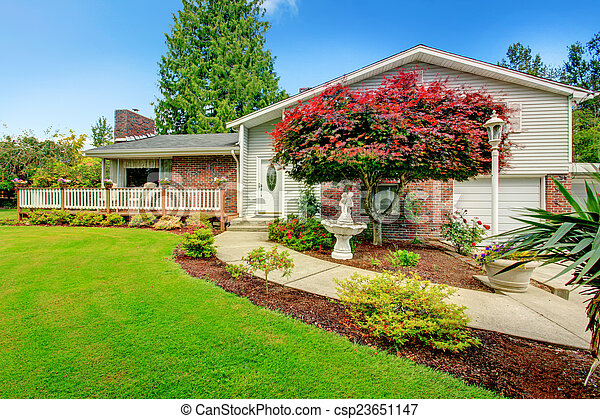 House exterior with brick wall trim - csp23651147