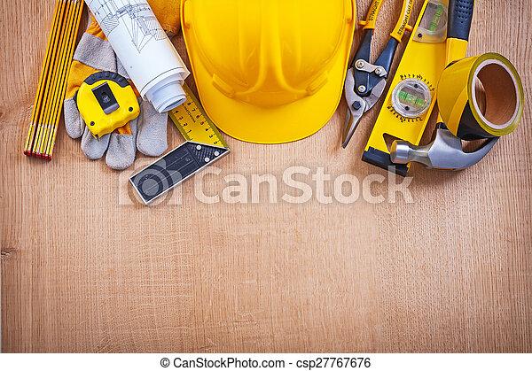 House improvement tools on oak wooden board construction concept - csp27767676