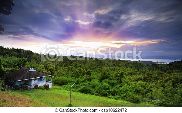 House in hill with sunrise - csp10622472