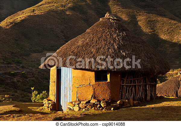 House in the mountains at sunset - csp9014088