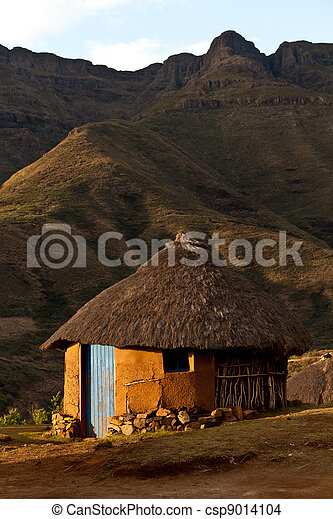 House in the mountains at sunset - csp9014104