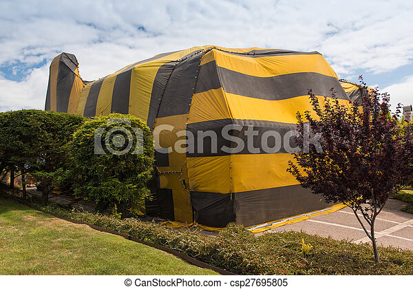 House is covered by tent for fumigation - csp27695805