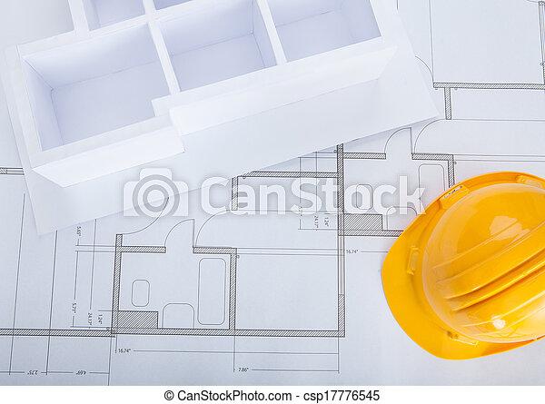 High angle view of house model on blueprint with hardhat stock photo house model on blueprint csp17776545 malvernweather Choice Image