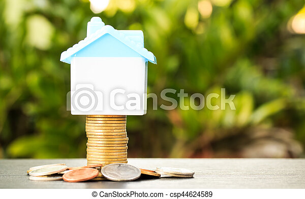 House on a pile of money - csp44624589