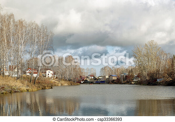 House on a pond in autumn - csp33366393