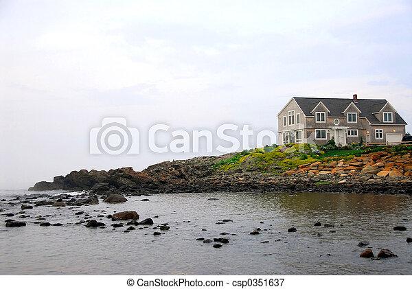 House on ocean shore - csp0351637