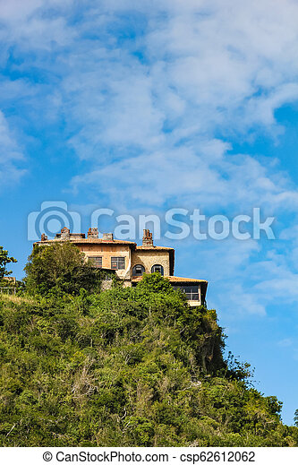House On Top Of A Hill On The River Bank On The Dominican Republic