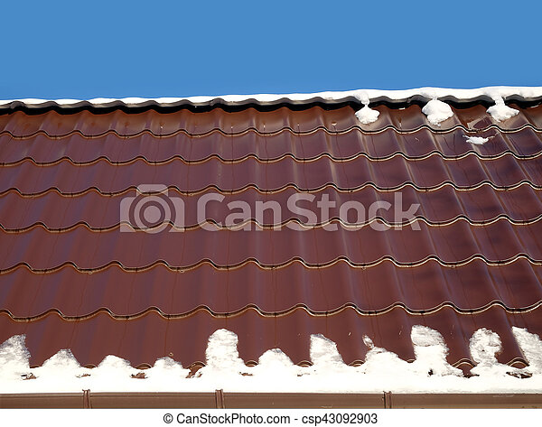 House roof from brown metal tile closeup - csp43092903