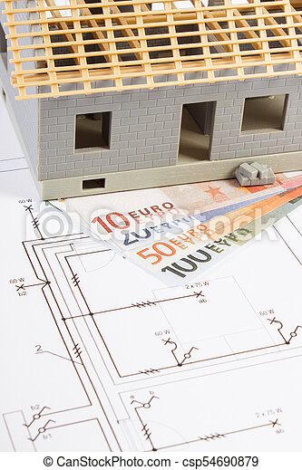 House under construction and currencies euro with electrical diagrams for project, building home cost concept - csp54690879