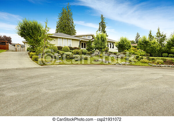 House with beautiful front yard landscape design - csp21931072