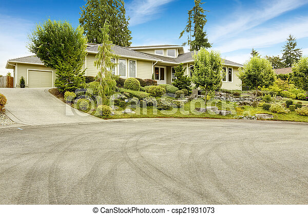 House with beautiful front yard landscape design - csp21931073