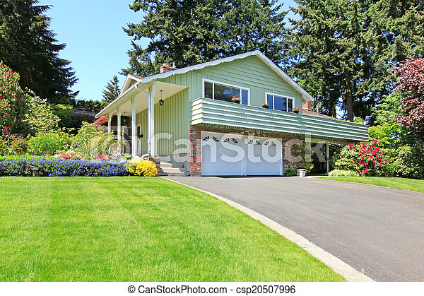 House with brick wall trim and garage - csp20507996