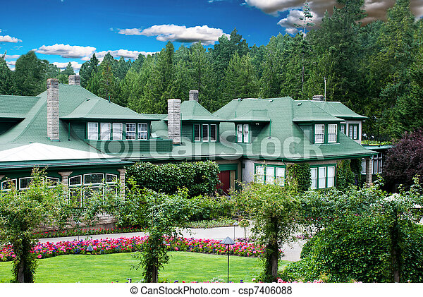 house with flower garden. Big beautiful house with colorful ...
