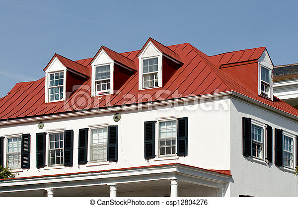 House With Red Roof And Dormer Windows Stock Photo