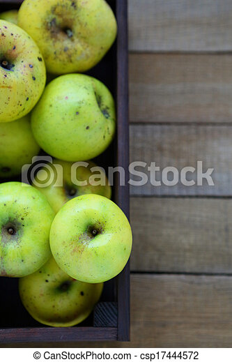 household apples in wooden crate, top view - csp17444572
