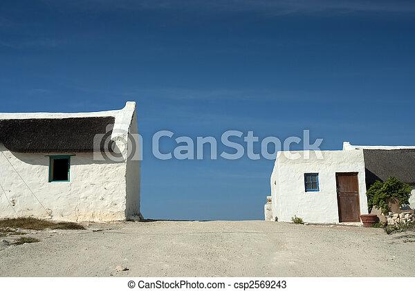 Houses alongside a dirt road - csp2569243