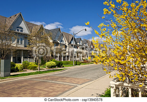 Houses on residential street in spring - csp13940578