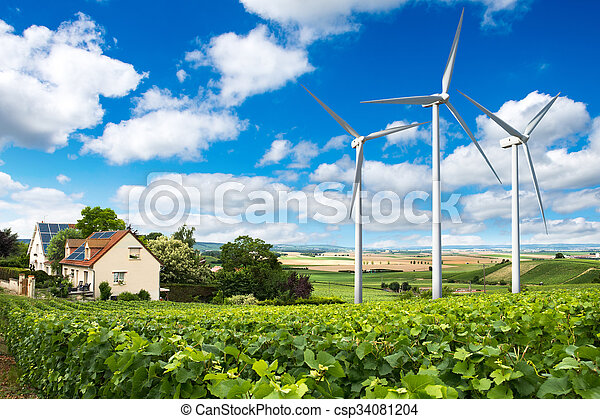 Houses with solar panels on roof and wind turbines - csp34081204