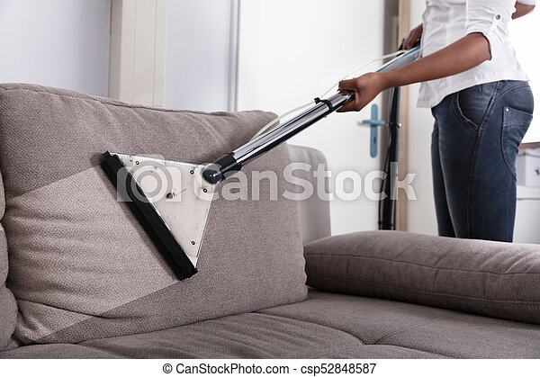 Perfect Housewife Cleaning Sofa With Vacuum Cleaner   Csp52848587