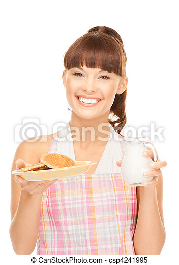 housewife with milk and cookies - csp4241995