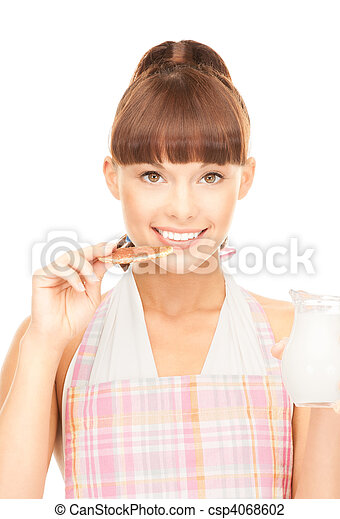housewife with milk and cookies - csp4068602
