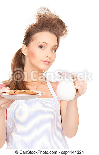 housewife with milk and cookies - csp4144324