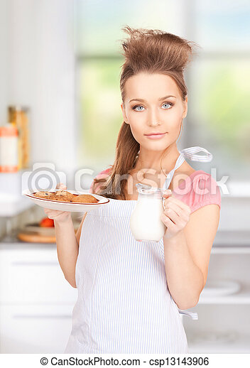 housewife with milk and cookies - csp13143906
