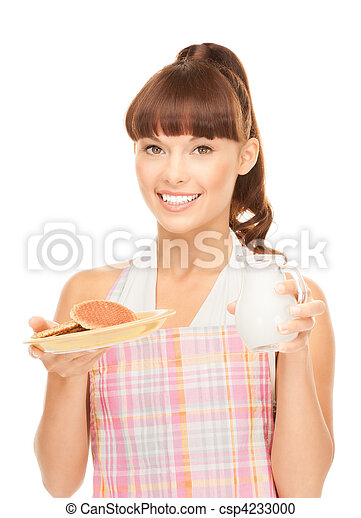 housewife with milk and cookies - csp4233000