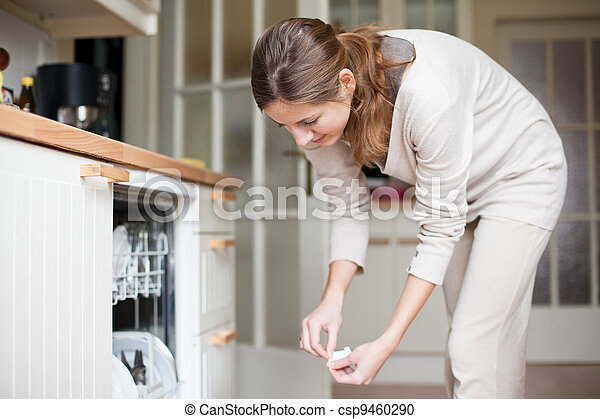 Housework: young woman putting dishes in the dishwasher - csp9460290