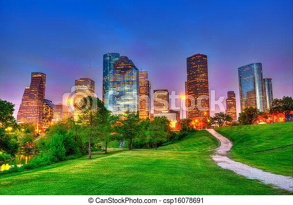 Houston Texas modern skyline at sunset twilight on park - csp16078691