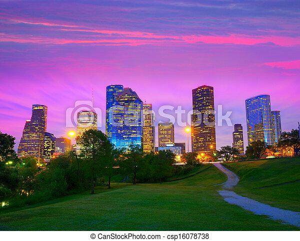 Houston Texas modern skyline at sunset twilight from park - csp16078738