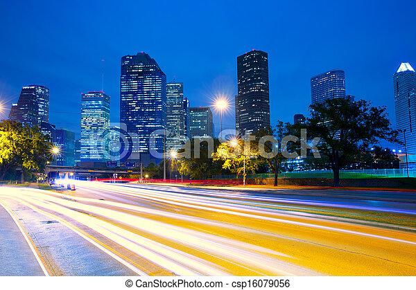 Houston Texas skyline at sunset with traffic lights - csp16079056