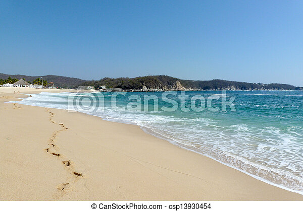 Huatulco beach with footprints - csp13930454