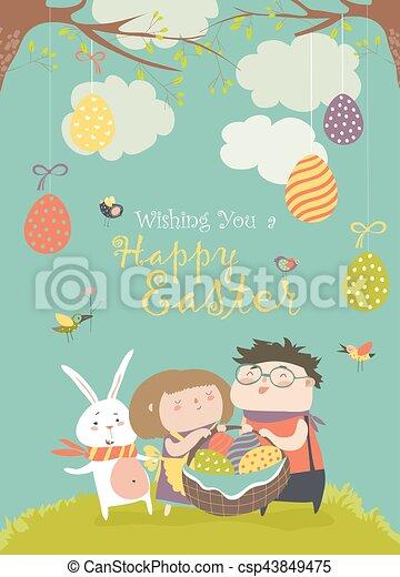 Niños felices sosteniendo una canasta de huevos de Pascua - csp43849475