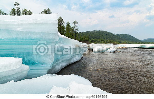 Huge blocks of turquoise layered ice on the river - csp69146494
