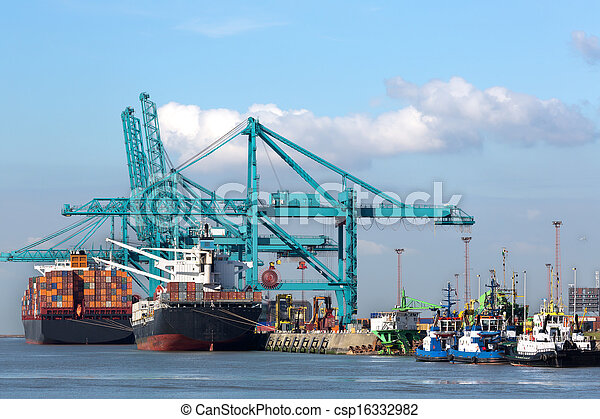 Huge container ships being loaded with cranes in Antwerp container terminal - all recognizable logos and brands have been removed  - csp16332982
