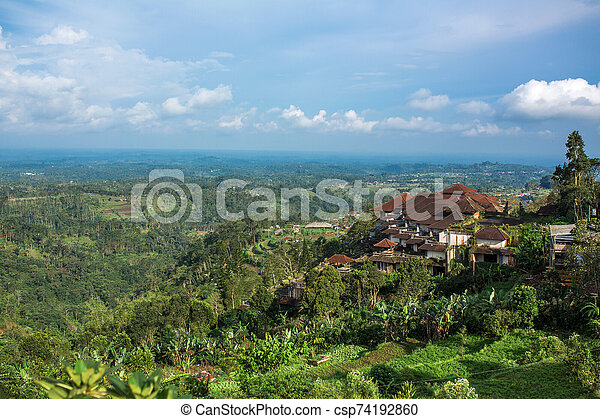 Huge hotel complex on a hill with a landscape view of the green jungle - csp74192860